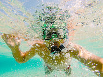 Swimmer blowing air bubbles Royalty Free Stock Image