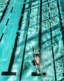 Aerial shot of Swimmer in blue swimming pool Stock Photo