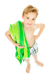 Swimmer: Boy with Towel Ready to Swim. Young Caucasian boy in swimsuit, isolated on white Stock Photography