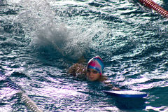 Swimmer breathing performing the crawl stroke Royalty Free Stock Images