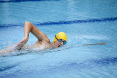Swimmer in cap breathing during front crawl Royalty Free Stock Photography