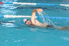 Swimmer in comptition Stock Photos