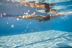 Swimmer in crawl style underwater Royalty Free Stock Photos