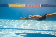 Swimmer in crawl style underwater Royalty Free Stock Images