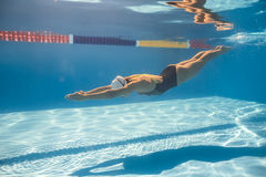 Swimmer in crawl style underwater Stock Images