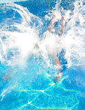Swimmer dives. A swimmer dives into the water in pool Royalty Free Stock Photos
