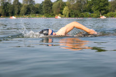 Swimmer doing forward crawl swimming stroke Stock Photos