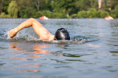 Swimmer doing forward crawl swimming stroke Royalty Free Stock Photos