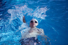 Swimmer excercise on indoor swimming poo Stock Image