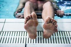 Swimmer foot on the edge of the swimming pool. Close up view of swimmer foot on the edge of the swimming pool Stock Photos