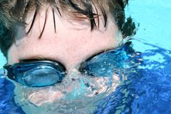 Swimmer with Goggles. Blowing bubbles under water Stock Photos