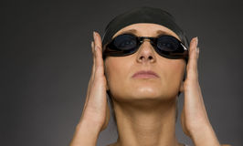 Swimmer hat cap goggles athlete preparing swim Royalty Free Stock Photo
