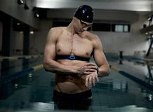 Swimmer with heart rate monitor Stock Images