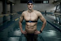 Swimmer with heart rate monitor Royalty Free Stock Photos