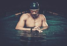 Swimmer with heart rate monitor Royalty Free Stock Images