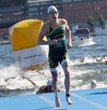 Swimmer Henri Schoeman (RSA) climbing up from the water Stock Images