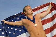 Swimmer Holding An American Flag Royalty Free Stock Images