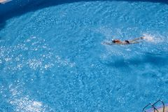 Swimmer in a hotel. Swimmer at swimming pool, in a hotel royalty free stock photo