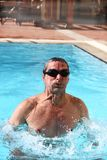 Swimmer in a hotel's pool Stock Photos