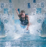 Swimmer jumping in swimming pool Stock Photo