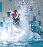 Swimmer jumping in swimming pool Stock Photos