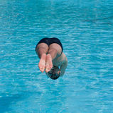 Swimmer jumping into water. Swimmer jumping into blue water Stock Photography