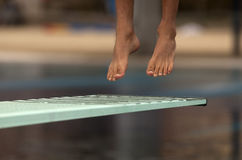 Swimmer launched into water. In a diving competition royalty free stock photo