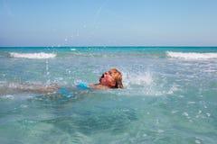 Swimmer in Mediterranean sea. Stock Photo