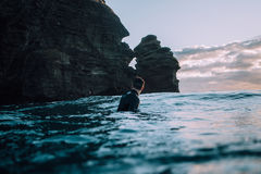 Swimmer off rocky cliff Stock Image