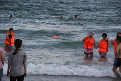 The swimmer with orange jacket in SHENZHEN Royalty Free Stock Image