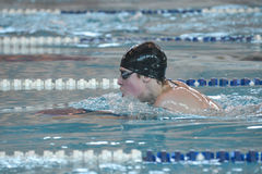 Swimmer is participating in the competition Stock Photos