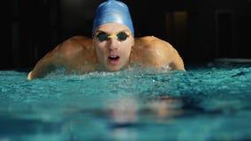 Swimmer performing butterfly stroke. Slowmo stock video