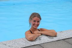 The swimmer in the pool. A girl swimming in the pool Stock Image