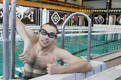 Swimmer in the pool showing thumbs up. Stock Photo