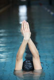 Swimmer  raising hands, preparing to swim in swimming pool Stock Photography
