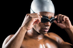 Swimmer ready to dive. On black background Stock Photo