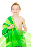 Swimmer: Ready to Swim with Towel and Tube. Young Caucasian boy in swimsuit, isolated on white Stock Photos