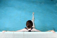 Swimmer relaxing in pool royalty free stock photos
