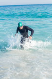 Swimmer running in the ocean Royalty Free Stock Photo