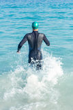 Swimmer running in the ocean Stock Photography
