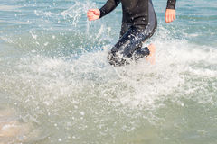 Swimmer running in the ocean Stock Photos