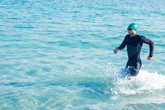 Swimmer running in the ocean Stock Images