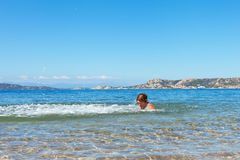 Swimmer at Sardinia coast. Royalty Free Stock Photography