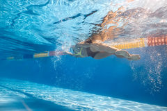 Swimmer in sidestroke style underwater Royalty Free Stock Images