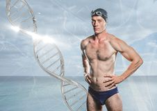 swimmer with silver dna chain in front of the sea Stock Image