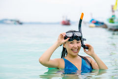 Swimmer with snorkling glasses. Pretty asian woman wearing underwater snorkling glasses Stock Image