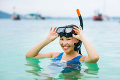 Swimmer with snorkling glasses. Pretty asian woman wearing underwater snorkling glasses Stock Photos