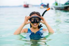 Swimmer with snorkling glasses. Pretty asian woman wearing underwater snorkling glasses Stock Photography