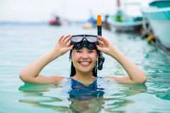 Swimmer with snorkling glasses. Pretty asian woman wearing underwater snorkling glasses Royalty Free Stock Images