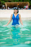 Swimmer with snorkling glasses. Pretty asian woman wearing underwater snorkling glasses Royalty Free Stock Photography